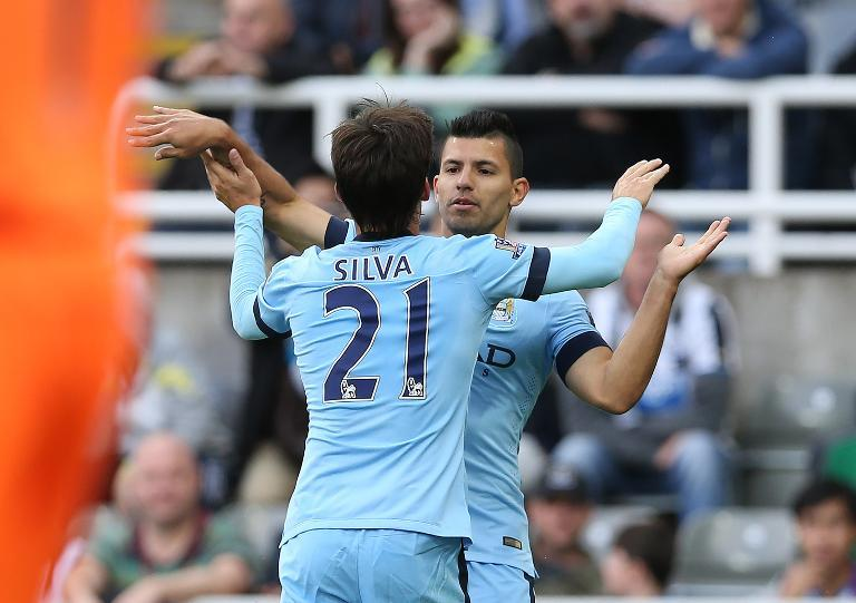 Manchester City's David Silva (L) and Sergio Aguero celebrate Aguero's goal during their Premier League match against Newcastle United in Newcastle-upon-Tyne on August 17, 2014