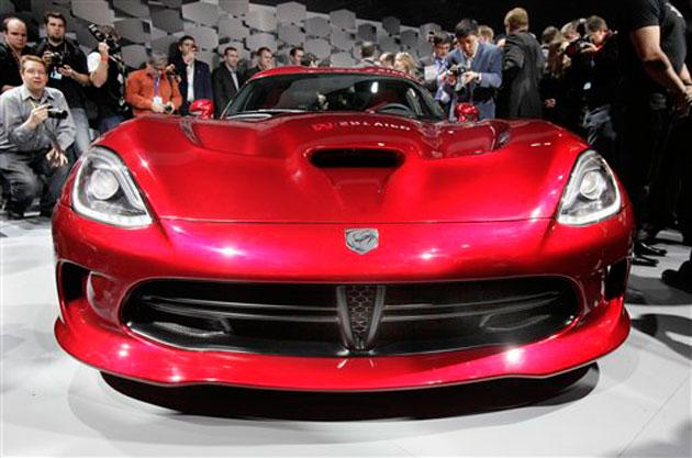The SRT Viper is unveiled at the New York International Auto Show, in New York's Javits Center, Wednesday, April 4, 2012. (AP Photo/Richard Drew)