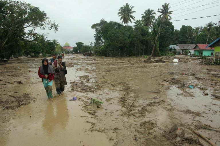 More than 14,000 people on the island of Sulawesi have been left homeless after flash floods engulfed thousands of houses in mud