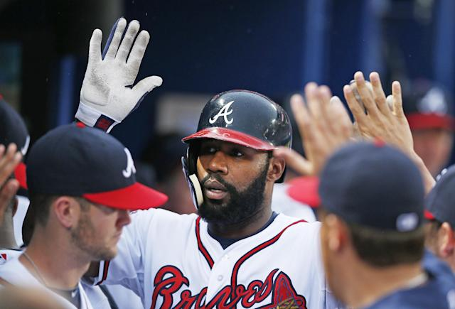 Atlanta Braves' Jason Heyward celebrates with his teammates in the dugout after hitting a home run in the second inning of a baseball game against the Philadelphia Phillies in Atlanta, Friday, July 18, 2014. (AP Photo/John Bazemore)