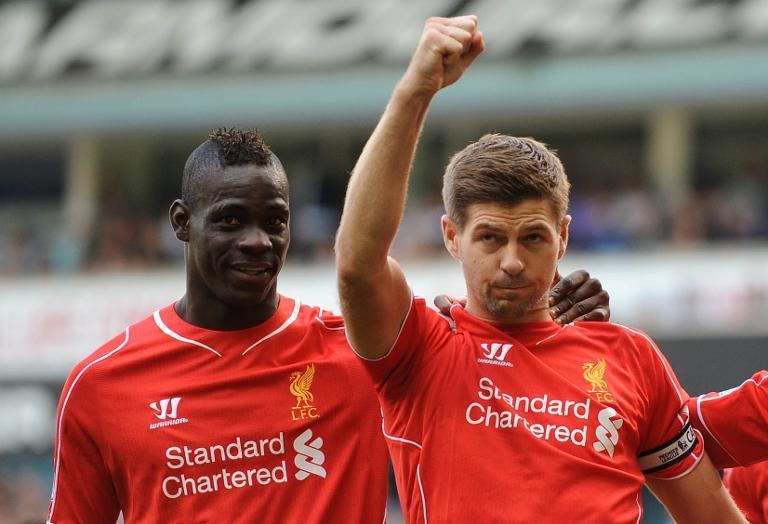 Liverpool's Steven Gerrard (R) celebrates with teammate Mario Balotelli after scoring a penalty during their Premier League match against Tottenham Hotspur at White Hart Lane on August 31, 2014
