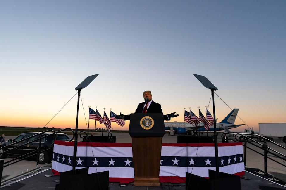 <p>Donald Trump speaks at a campaign rally at Rochester International Airport in Minnesota on 30 October.</p> (AP)