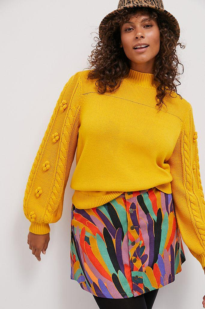 """<h2>Kiara Textured Sweater</h2><br>The boho balloon sleeves on this sunflower-hued sweater — available in petite, standard, and plus sizes — are adorned with sweet floral and cable-knit embellishments that will keep your look from veering into plain-Jane territory. <br><br><strong>Maeve</strong> Kiara Textured Sweater, $, available at <a href=""""https://go.skimresources.com/?id=30283X879131&url=https%3A%2F%2Fwww.anthropologie.com%2Fshop%2Fkiara-textured-sweater%3Fcategory%3Dplus-size-sweaters%26color%3D079%26type%3DSTANDARD%26viewcode%3Dc%26quantity%3D1"""" rel=""""nofollow noopener"""" target=""""_blank"""" data-ylk=""""slk:Anthropologie"""" class=""""link rapid-noclick-resp"""">Anthropologie</a>"""