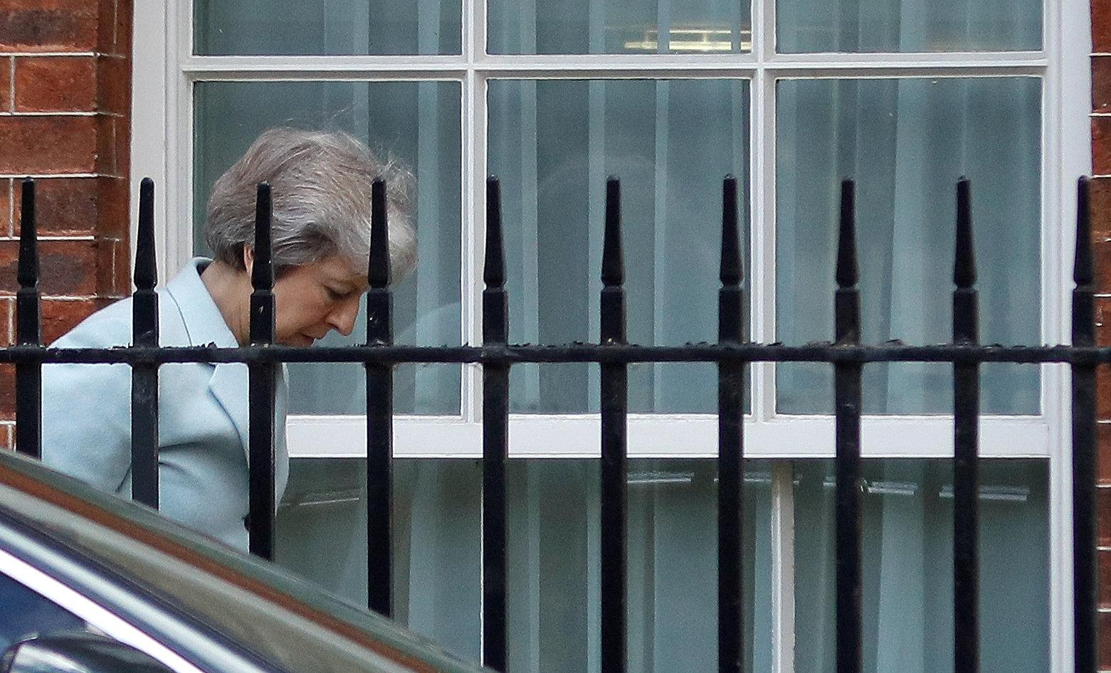 Theresa May arrives at the back entrance of 10 Downing Street ahead of an update on Brexit negotiations (Picture: Reuters)