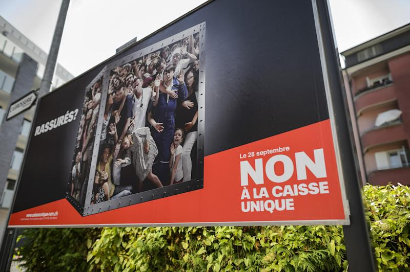 A campaign poster against a single health insurance public system is seen on September 28, 2014 in Vevey (AFP Photo/Fabrice Coffrini )