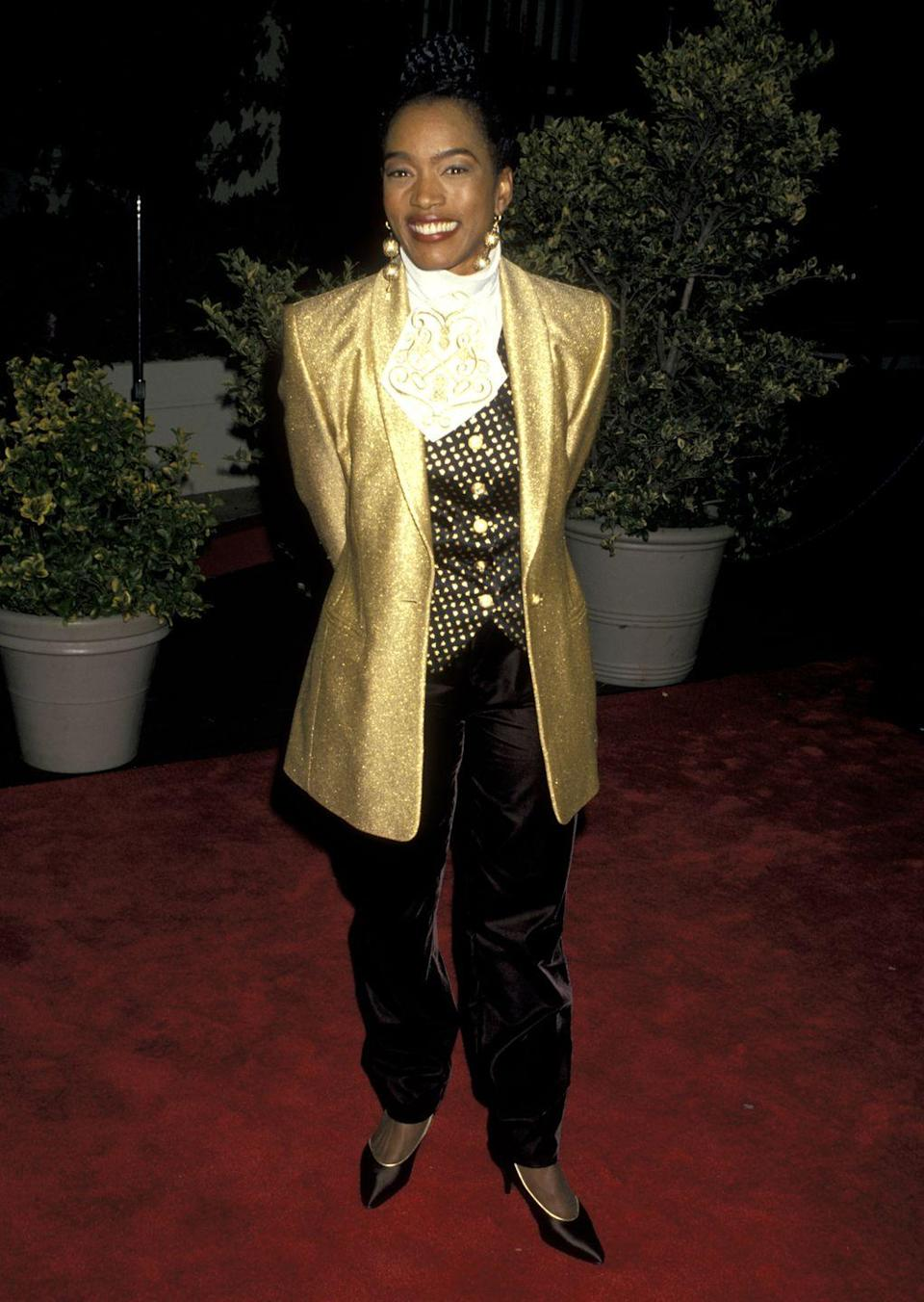 <p>Angela straight-up glowed at the People's Choice Awards in a bright gold jacket. She really committed to the three-piece suit with a polka-dot vest, ruffled dress shirt, and pants. </p>