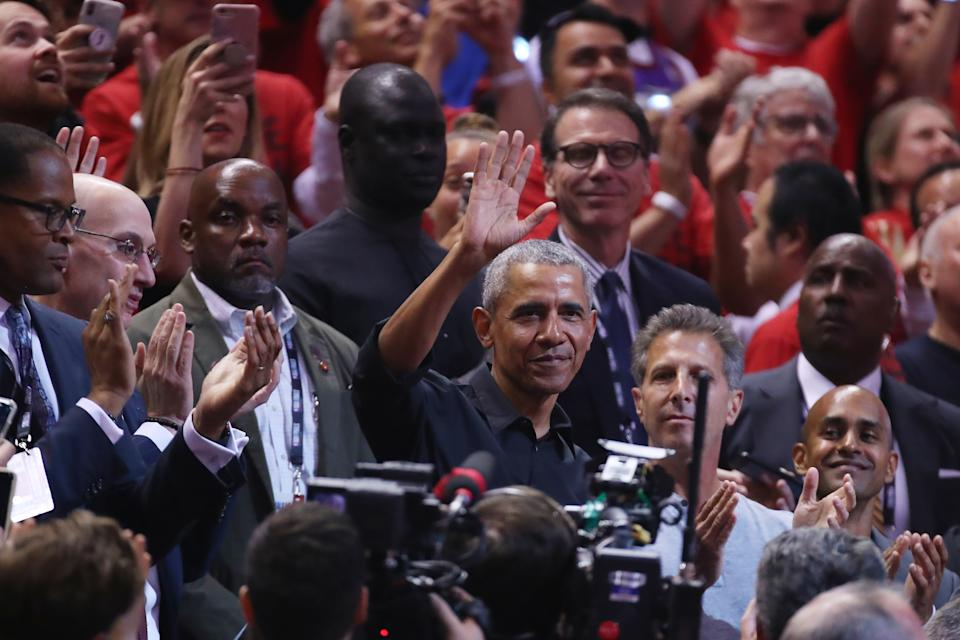 Former President of the United States, Barack Obama waves to the crowd during Game Two of the 2019 NBA Finals between the Golden State Warriors and the Toronto Raptors at Scotiabank Arena on June 02, 2019 in Toronto, Canada. (Photo by Gregory Shamus/Getty Images)