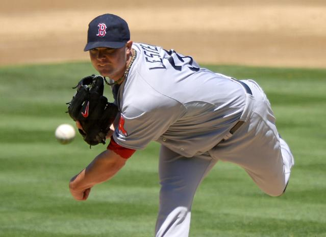 Boston Red Sox starting pitcher Jon Lester throws to the plate during the second inning of a baseball game against the Los Angeles Dodgers, Saturday, Aug. 24, 2013, in Los Angeles. (AP Photo/Mark J. Terrill)