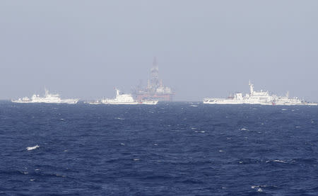 Chinese oil rig Haiyang Shi You 981 is seen surrounded by ships of China Coast Guard in the South China Sea
