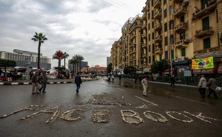 """Facebook"" is written with stones in Cairo's Tahrir Square on February 6, 2011, the epicenter of anti-regime protests"