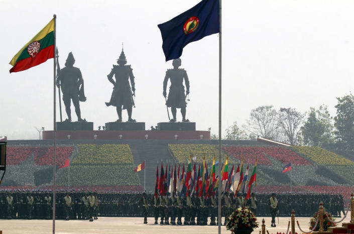 Myanmar soldiers march in formation during a ceremony to mark the 67th anniversary of Armed Forces Day at the parade ground in Naypyitaw, Myanmar Tuesday, March 27, 2012. (AP Photo/Khin Maung Win)