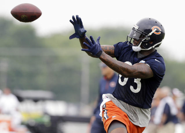 Chicago Bears tight end Martellus Bennett (83) catches a ball during the team's NFL football training camp on Saturday, July 26, 2014, in Bourbonnais, Ill. (AP Photo/Nam Y. Huh)