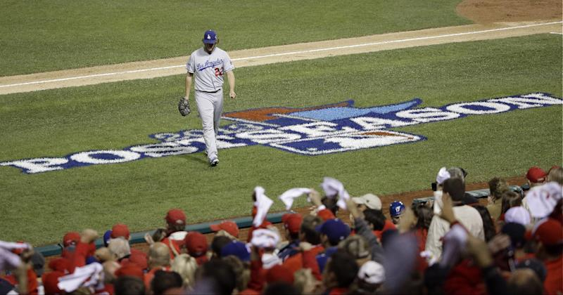 Los Angeles Dodgers starting pitcher Clayton Kershaw walks back to the dugout after the third inning of Game 6 of the National League baseball championship series against the St. Louis Cardinals Friday, Oct. 18, 2013, in St. Louis. The Cardinals scored four runs in the inning. (AP Photo/Charlie Neibergall)