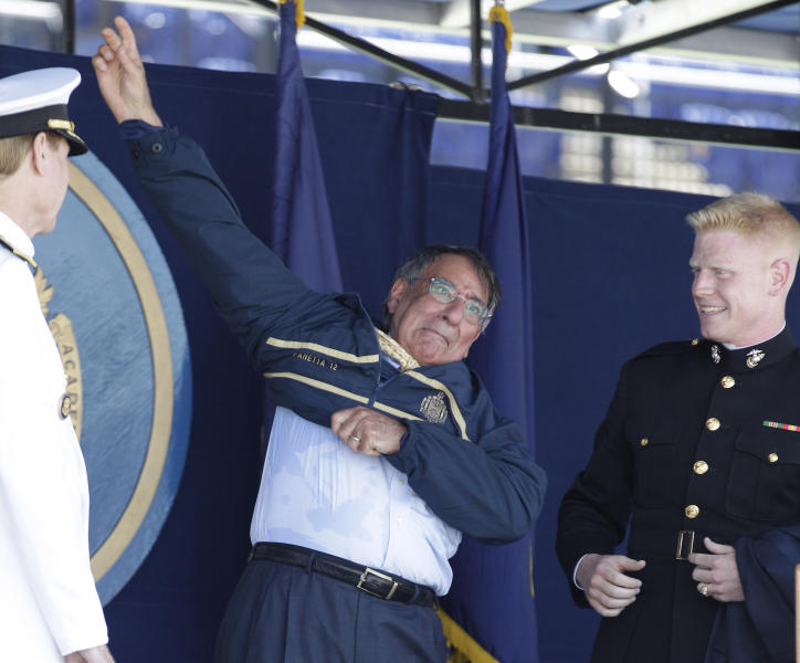 Secretary of Defense Leon Panetta, center, reacts as he slips into a United States Naval Academy jacket during the Academy's graduation and commissioning ceremonies in Annapolis, Md., Tuesday, May 29, 2012. Panetta received the jacket as a gift from Academy Superintendent, Vice Admiral Michael H. Miller, left, and U.S. Marine Second Lt. Ian Cameron, of Rochester, Minn., president of the Class of 2012. (AP Photo/Patrick Semansky)