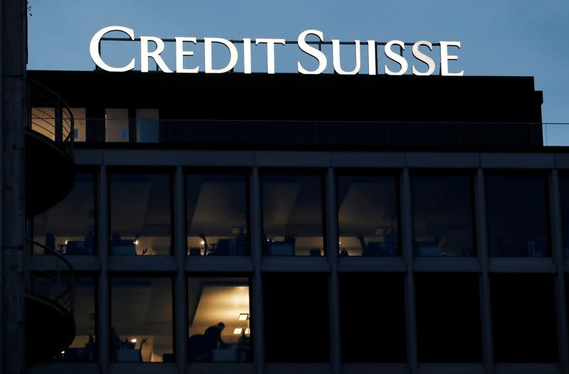 FILE PHOTO: A logo of Credit Suisse is pictured on a building in Geneva
