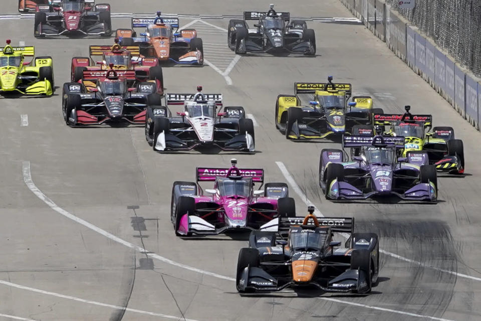 Pole sitter Pato O'Ward leads the field during the first race of the IndyCar Detroit Grand Prix auto racing doubleheader on Belle Isle in Detroit Saturday, June 12, 2021. (AP Photo/Paul Sancya)
