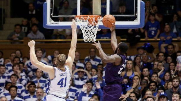 PHOTO: Stephen F. Austin forward Nathan Bain drives for a game-winning basket over Duke forward Jack White during overtime in an NCAA college basketball game in Durham, N.C., Tuesday, Nov. 26, 2019. (Gerry Broome/AP)