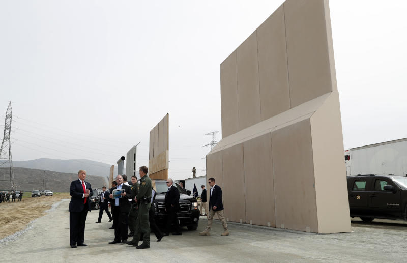 President Donald Trump tours U.S.-Mexico border wall prototypes near the Otay Mesa Port of Entry in San Diego. (Kevin Lamarque / Reuters)