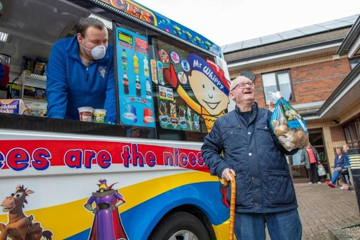 An ice cream van in Belfast is bringing essential supplies to the elderly and vulnerable forced to stay at home (AFP Photo/Paul Faith)