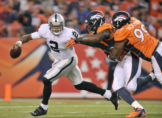 Oakland Raiders quarterback Terrelle Pryor (2) scrambles away from Denver Broncos defensive end Robert Ayers (91) and defensive tackle Kevin Vickerson (99) in the second quarter of an NFL football game, Monday, Sept. 23, 2013, in Denver. (AP Photo/Jack Dempsey)