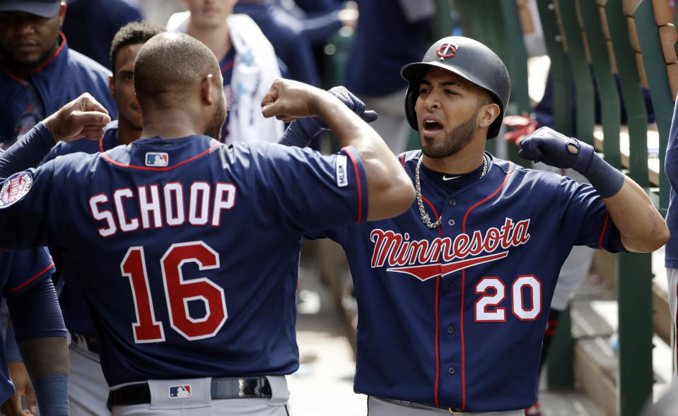 Minnesota Twins' Eddie Rosario (20) celebrates his solo home run in the dugout with teammate Jonathan Schoop (16) during the eighth inning of the team's baseball game against the Los Angeles Angels on Thursday, May 23, 2019, in Anaheim, Calif. (AP Photo/Marcio Jose Sanchez)