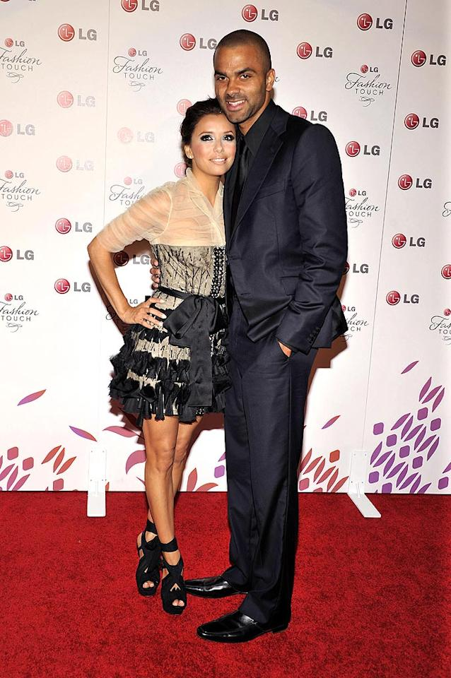"""The """"Desperate Housewives"""" hostess stopped off for a quick cuddle with her hubby, San Antonio Spurs player Tony Parker. Toby Canham/<a href=""""http://www.gettyimages.com/"""" target=""""new"""">GettyImages.com</a> - May 24, 2010"""