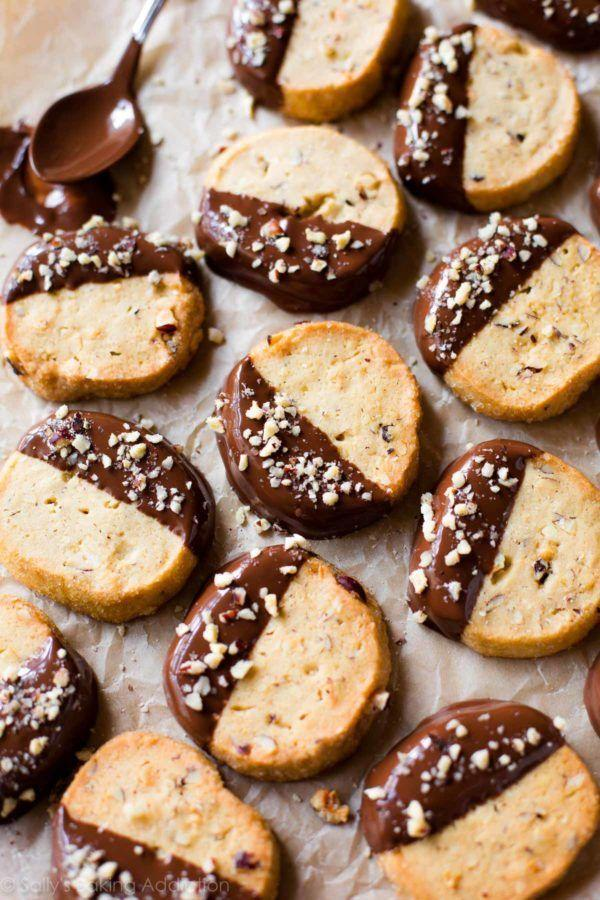 """<p>Surprisingly, hazelnuts are a major industry in Oregon, and lucky for locals, the rich flavor is an amazing way to change up classic cookie recipes. These slice-and-bake Toasted Hazelnut Cookies<span class=""""redactor-invisible-space""""> when dipped in rich chocolate, taste remarkably like Nutella.</span></p><p>Get the recipe from <a href=""""https://sallysbakingaddiction.com/2015/12/11/toasted-hazelnut-slice-n-bake-cookies-with-milk-chocolate/"""" rel=""""nofollow noopener"""" target=""""_blank"""" data-ylk=""""slk:Sally's Baking Addiction"""" class=""""link rapid-noclick-resp"""">Sally's Baking Addiction</a>.</p>"""