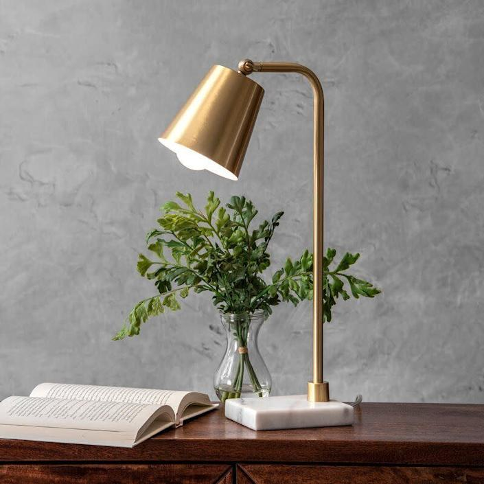 """You won't have to worry about finding a bulb for this lamp &mdash; it already comes with a B22 bulb. This gold desk lamp can go with almost anything, especially with its marble-like base. It features a three-way switch, too.<br> <a href=""""https://fave.co/2ZFifRb"""" rel=""""nofollow noopener"""" target=""""_blank"""" data-ylk=""""slk:Find it for $59 at Wayfair"""" class=""""link rapid-noclick-resp"""">Find it for $59 at Wayfair</a>."""