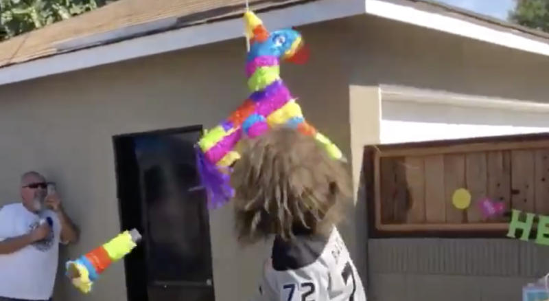 Bailey had to bust through a piñata that was seemingly made of concrete and Kevlar in order to complete his mission. (Twitter//@BaileyLAKings)