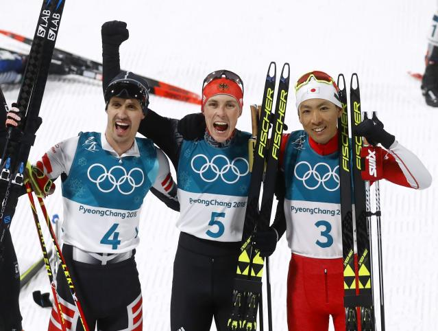 Nordic Combined Events - Pyeongchang 2018 Winter Olympics – Men's Individual 10km Final – Alpensia Cross-Country Skiing Centre - Pyeongchang, South Korea – February 14, 2018. Lukas Klapfer of Austria, Eric Frenzel of Germany and Akito Watabe of Japan celebrate after the finish line. REUTERS/Kai Pfaffenbach