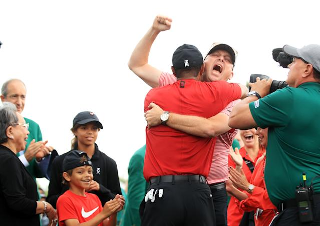 Tiger Woods (L) of the United States celebrates with Rob McNamara (R), Vice President of TGR Ventures, as he comes off the 18th green in celebration of his win during the final round of the Masters at Augusta National Golf Club on April 14, 2019 in Augusta, Georgia. (Photo by Andrew Redington/Getty Images)