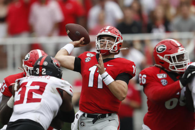 Georgia quarterback Jake Fromm (11) throws from the pocket in the first half of an NCAA college football game against Arkansas State Saturday, Sept. 14, 2019, in Athens, Ga. (AP Photo/John Bazemore)