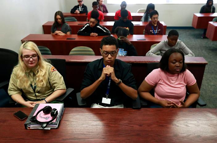 Students at Fort Lauderdale High School participate in a moment of silence during the one-year anniversary of the Marjory Stoneman Douglas High School shooting. (Photo: Wilfredo Lee/AP)