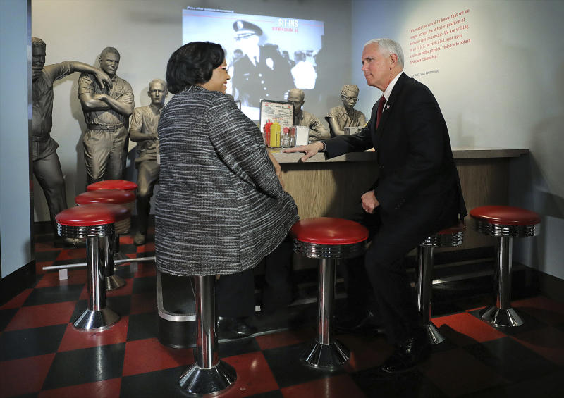 Vice President Mike Pence sits down with Director of Interpretation, Collections and Education Noelle Trent during a trip to the National Civil Rights Museum in Memphis Sunday, Jan. 19, 2020. Pence spoke at the church service in remembrance of the Rev. Martin Luther King Jr., the day before the federal holiday named after the civil rights leader. Pence says King touched the hearts of millions of Americans and his words continue to inspire. Pence acknowledged the nation's deep divide and says Americans must rededicate themselves to the ideals that King advanced. (Patrick Lantrip/Daily Memphian via AP)