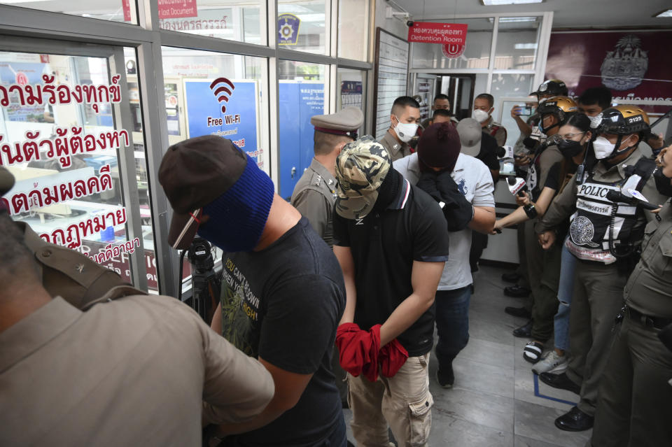 Four police officers with their face covers wanted in connection to the Thai murder of a drug dealing suspect at Nakhon Sawan station.