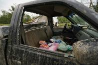 The wreckage of a truck is shown Monday, May 3, 2021, in Yazoo County, Miss. Multiple tornadoes were reported across Mississippi on Sunday, causing some damage but no immediate word of injuries. (AP Photo/Rogelio V. Solis)