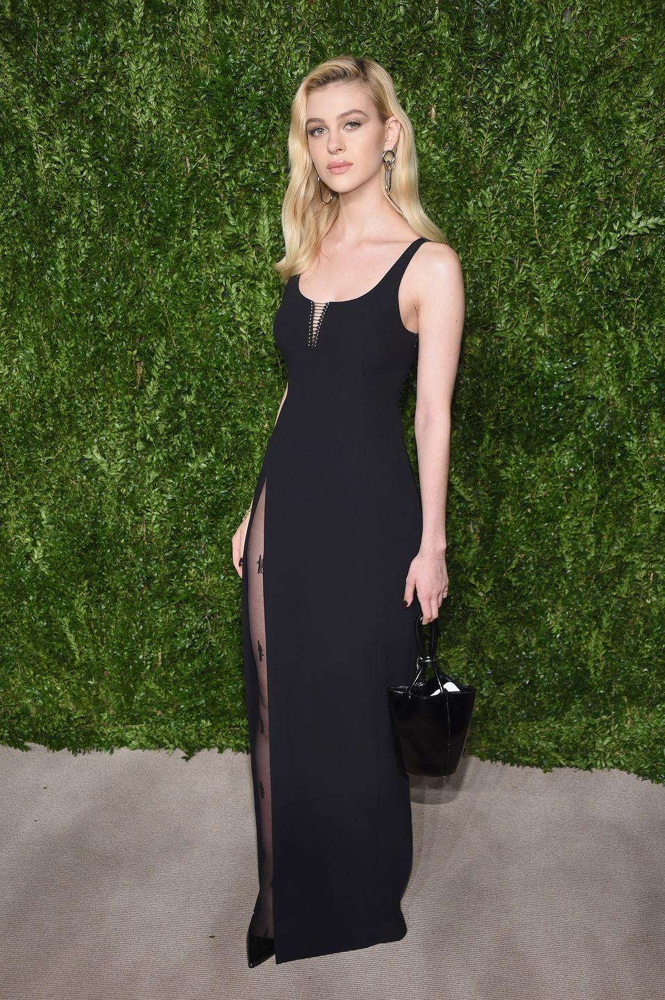 <p>Peltz chose to wear a black floor-length dress with a lace tie-up at the bust, teamed with a black bag and black printed tights to the CFDA/Vogue Fashion Fund Gala. <br></p>