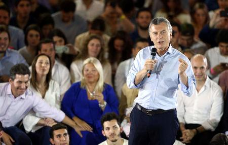 Argentina's President Mauricio Macri speaks in front of Buenos Aires province governor Maria Eugenia Vidal, Lower House candidate Elisa Carrio and Buenos Aires' city Mayor Horacio Rodriguez Larreta during a campaign rally ahead of mid-term elections in Buenos Aires, Argentina October 17, 2017. REUTERS/Marcos Brindicci