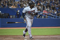Minnesota Twins' Miguel Sano watches his solo home run against the Toronto Blue Jays during the third inning of a baseball game Friday, Sept. 17, 2021, in Toronto. (Jon Blacker/The Canadian Press via AP)