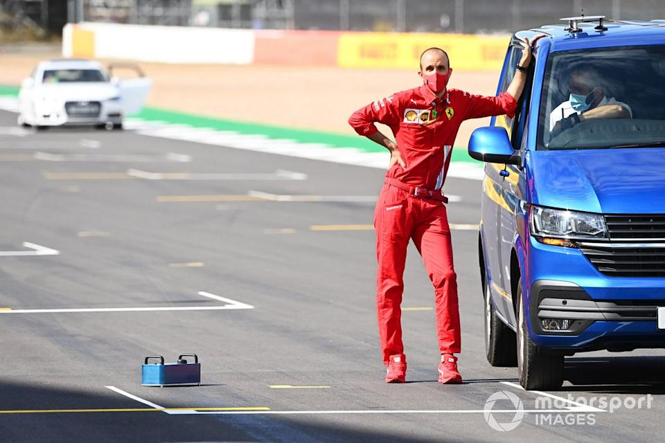 """A member of the Ferrari team stands on the grid<span class=""""copyright"""">Mark Sutton / Motorsport Images</span>"""