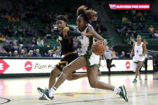 Grambling State guard Ariel Williams, left, defends against a drive to the basket by Baylor's DiDi Richards (2) during an NCAA college basketball game in Waco, Texas, Friday, Nov. 8, 2019. (AP Photo/Tony Gutierrez)