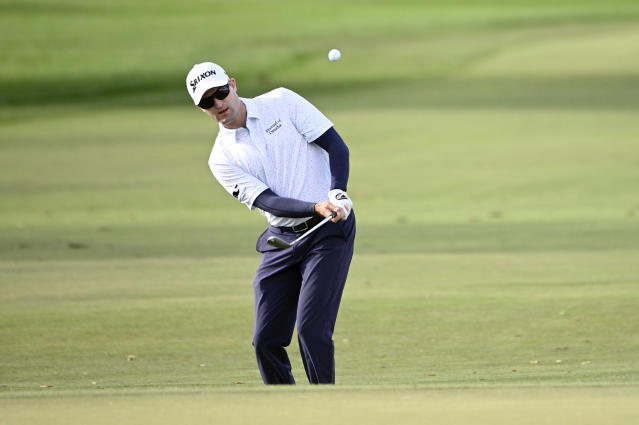 FILE - In this March 5, 2020, file photo, Russell Knox, of Scotland, chips onto the sixth green during the first round of the Arnold Palmer Invitational golf tournament in Orlando, Fla. Knox plans to drive his RV some 1,000 miles each way to PGA Tour events when they resume. (AP Photo/Phelan M. Ebenhack, File)