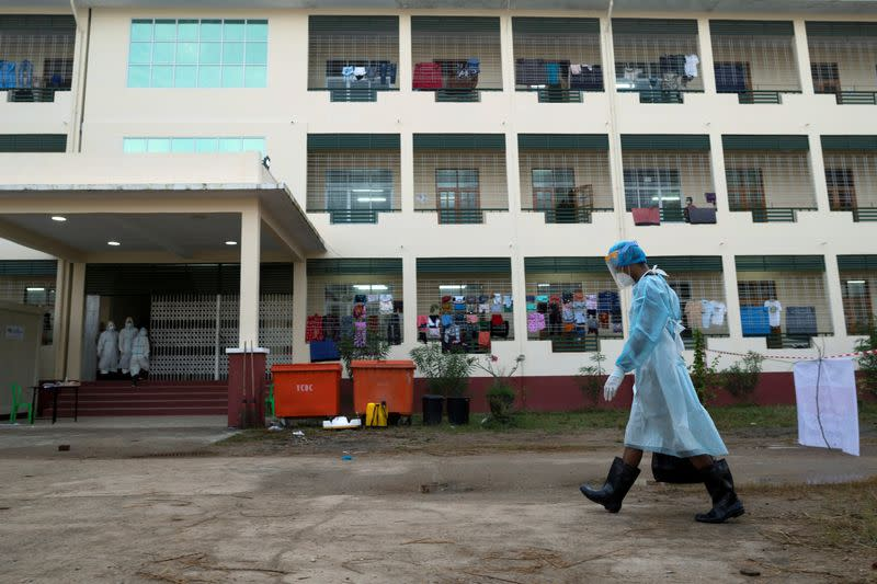 FILE PHOTO: A volunteer wearing a protective suit works at a quarantine center for people infected amid the outbreak of the coronavirus disease in Yangon