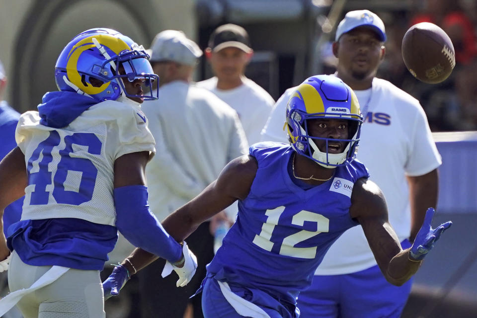 Los Angeles Rams wide receiver Van Jefferson (12) makes a catch in front of defensive back Kareem Orr (46) during an NFL football training camp practice Wednesday, July 28, 2021, in Irvine, Calif. (AP Photo/Marcio Jose Sanchez)