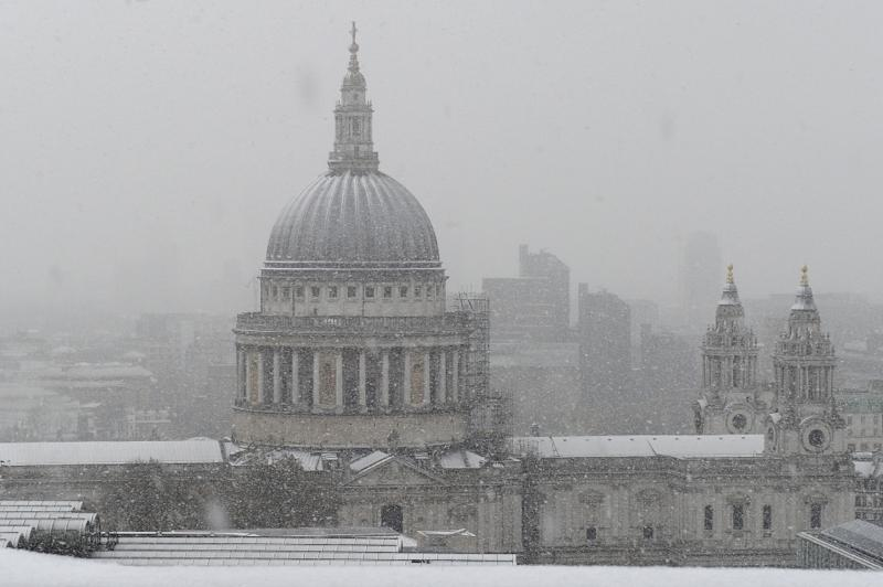 Britons battle heavy snow as transport hit by severe weather