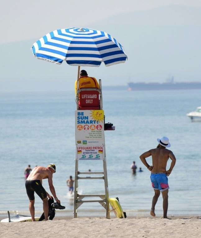 A lifeguard watches over Kits Beach, which is popular on hot days, in Vancouver