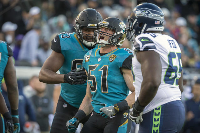 Jacksonville Jaguars linebacker Paul Posluszny made his retirement official at an emotional ceremony with teammate Telvin Smith. (AP)