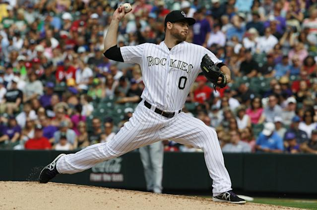Colorado Rockies relief pitcher Adam Ottavino works against the Cincinnati Reds in the third inning of a baseball game in Denver, Sunday, Sept. 1, 2013. (AP Photo/David Zalubowski)
