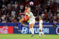 Steph Houghton of England competes for a header with Carli Lloyd of the USA during the 2019 FIFA Women's World Cup France Semi Final match between England and USA at Stade de Lyon on July 02, 2019 in Lyon, France. (Photo by Elsa/Getty Images)