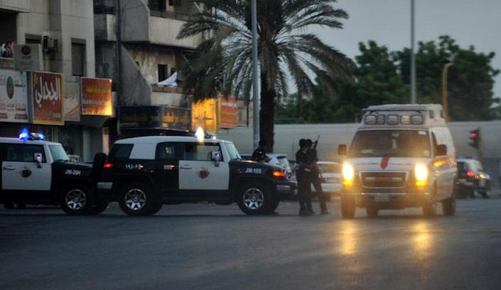 "Saudi police stand guard at the site of a suicide bombing in the early hours of July 4, 2016, near the American consulate in the Red Sea city of Jeddah Security officers became suspicious of a man near the parking lot of Dr Suleiman Faqeeh Hospital, which is directly across from the US diplomatic mission. When they moved in to investigate ""he blew himself up with a suicide belt inside the hospital parking"" at around 2:15 am, the ministry said, adding that two security officers were lightly injured. (AFP Photo/)"